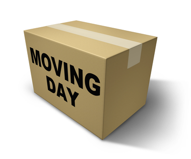 Moving day box representing movers and packaging for a move from one home to another